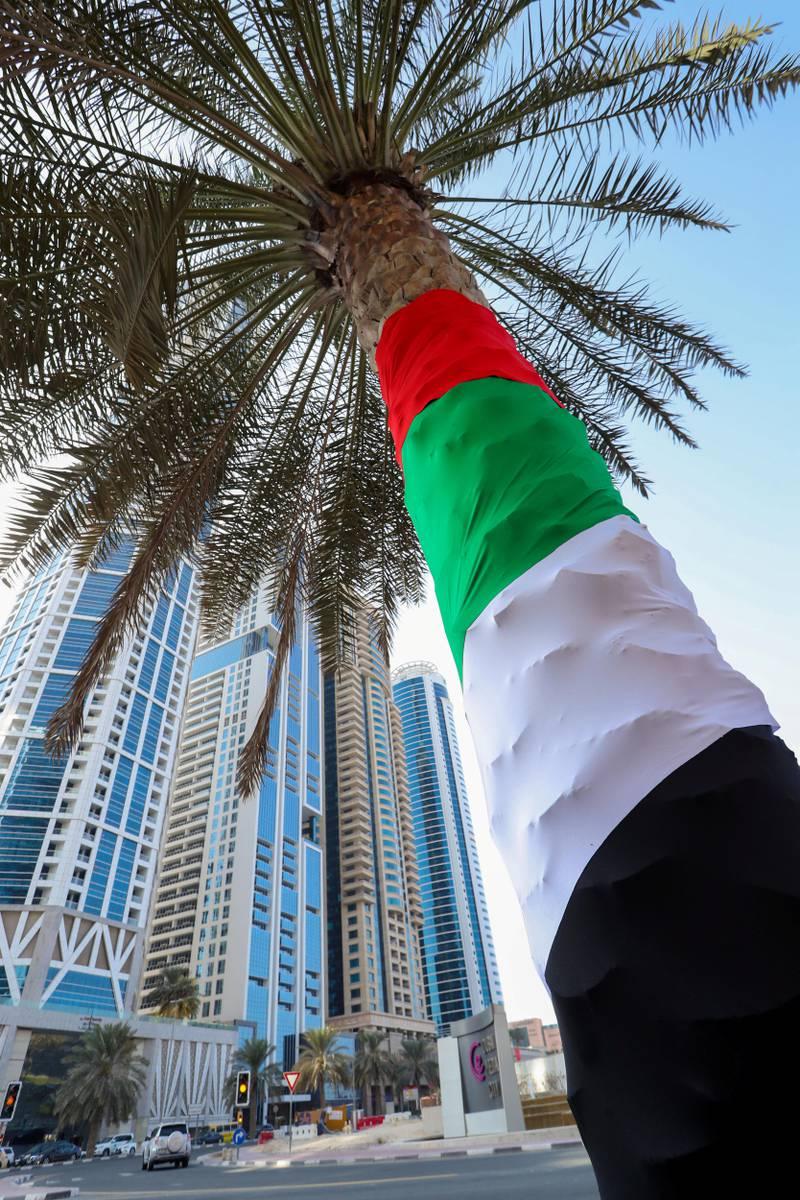 Dubai, United Arab Emirates - November 2nd, 2017: UAE flags up at Media City, Flag day. Thursday, November 2nd, 2017 at Media City, Dubai. Chris Whiteoak / The National