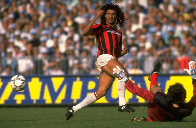May 1988:  Ruud Gullit (left) of AC Milan in action during the Serie A  match against Napoli in Napoli, Italy. AC Milan won the match 3-2. \ Mandatory Credit: Allsport UK /Allsport