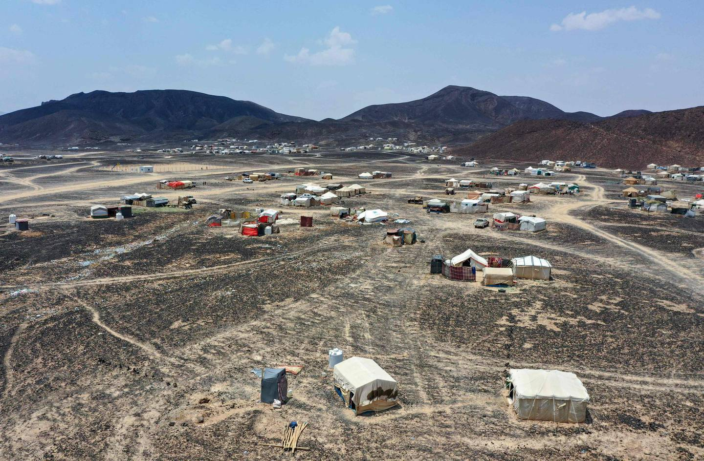 A general view shows the Suweida makeshift camp for internally displaced people in Yemen's Marib province on September 16, 2020. The Iran-backed fighters have long held the capital Sanaa which lies just 120 kilometres (75 miles) away and are mounting a fierce campaign to take the oil-rich province. If they are successful, it would spell disaster for the government and also for the hundreds of thousands of displaced people sheltering in desolate camps who would have to run for their lives once again. / AFP / -