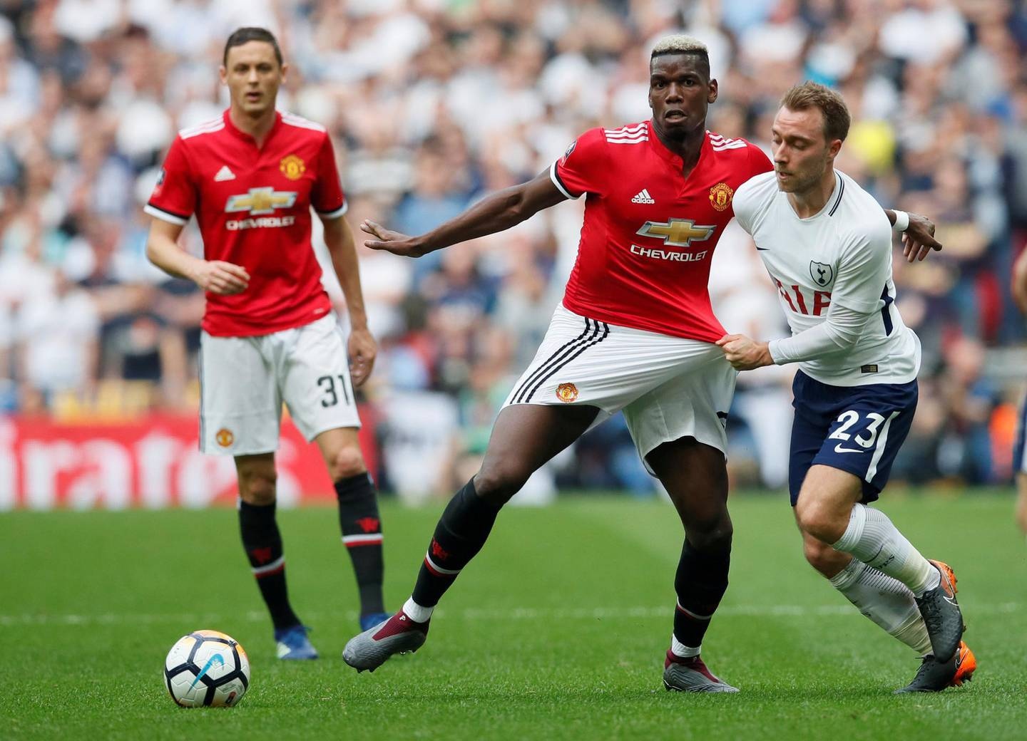 Soccer Football -  FA Cup Semi-Final - Manchester United v Tottenham Hotspur  - Wembley Stadium, London, Britain - April 21, 2018   Manchester United's Paul Pogba in action with Tottenham's Christian Eriksen   REUTERS/David Klein     TPX IMAGES OF THE DAY