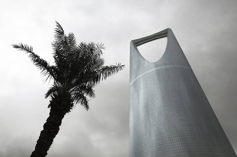 The Kingdom Tower, operated by Kingdom Holding Co., stands alongside palm tress in Riyadh, Saudi Arabia, on Saturday, Nov. 26, 2016. Saudi Arabia and the emirate of Abu Dhabi plan to more than double their production of petrochemicals to cash in on growing demand. Photographer: Simon Dawson/Bloomberg
