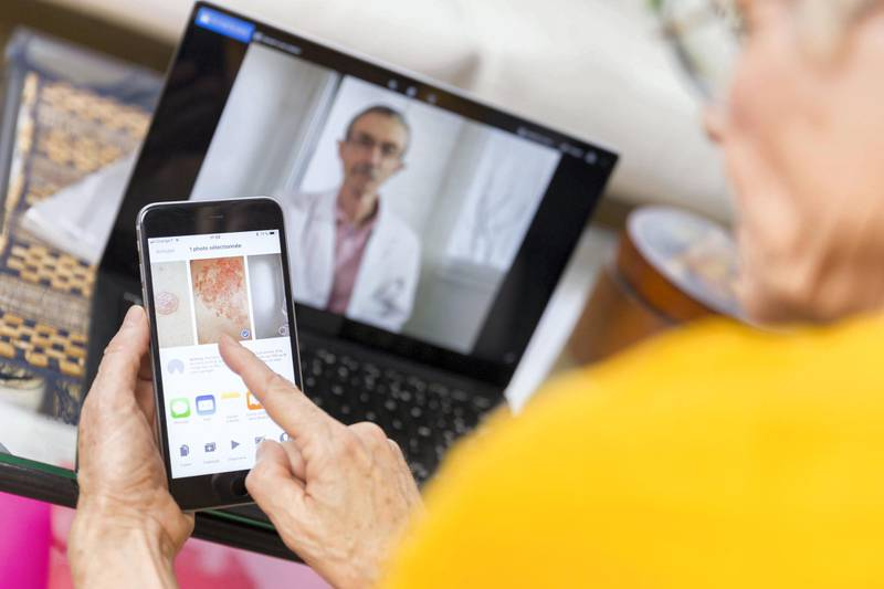 Senior woman teleconsulting from home. (Photo by: BSIP/Universal Images Group via Getty Images)