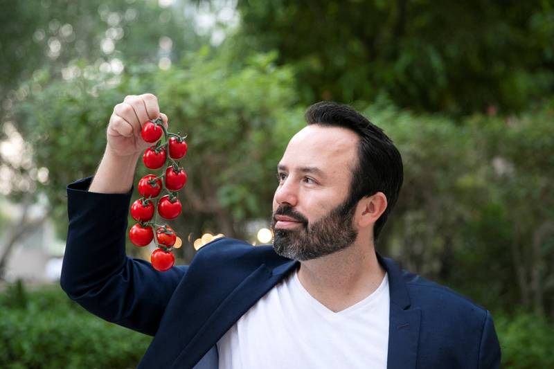 DUBAI, UNITED ARAB EMIRATES - OCTOBER 14, 2018.   Sky Kurtz, Founder of Pure Harvest, holds tomatoes harvested in his company's farm in Nahel.  (Photo by Reem Mohammed/The National)  Reporter:  Section:  NA