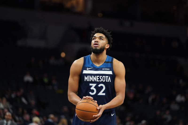 MINNEAPOLIS, MN - FEBRUARY 5: Karl-Anthony Towns #32 of the Minnesota Timberwolves shoots a free throw against the Atlanta Hawks on February 5, 2020 at Target Center in Minneapolis, Minnesota. NOTE TO USER: User expressly acknowledges and agrees that, by downloading and or using this Photograph, user is consenting to the terms and conditions of the Getty Images License Agreement. Mandatory Copyright Notice: Copyright 2020 NBAE   Jordan Johnson/NBAE via Getty Images/AFP