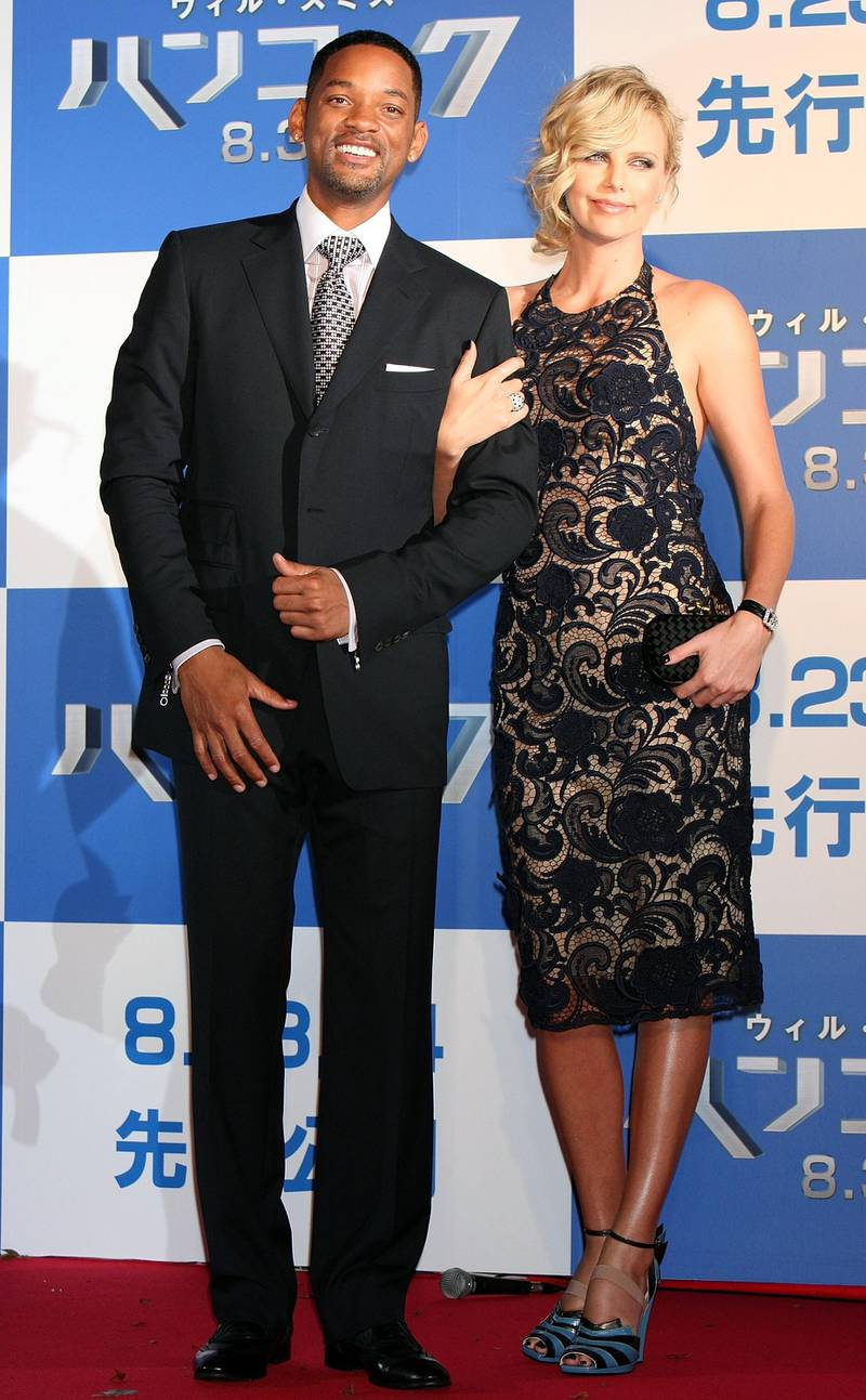 """TOKYO - AUGUST 21:  Actor Will Smith (L) and actress Charlize Theron (R) attend the """"Hancock"""" Japan Premiere at JCB Hall on August 21, 2008 in Tokyo, Japan. The film will open on August 30 in Japan.  (Photo by Junko Kimura/Getty Images)"""