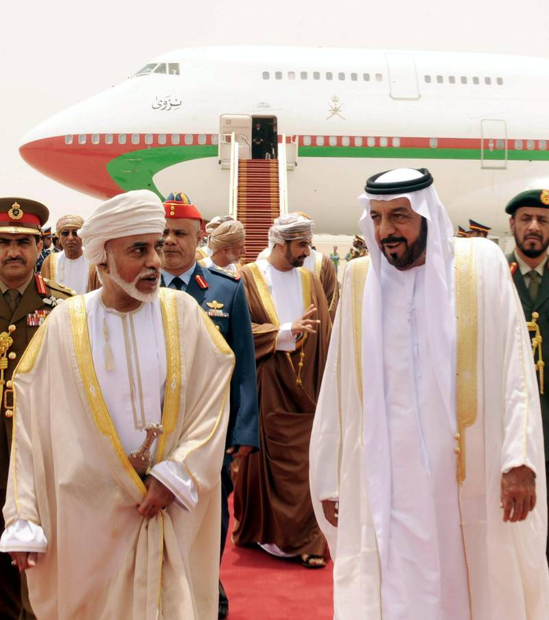 epa02819883 A handout picture released by Emirates News Agency (WAM) shows United Arab Emirates's President and Ruler of Abu Dhabi Sheikh Khalifa bin Zayed al-Nahayan(R) walking with His Majesty Oman's leader Sultan Qaboos bin Said (L) upon his arrival to al-Ain Airport , United Arab Emirates on 11 July 2011. Reports state that Sulatn Qaboos is visiting the state on the invitation of President Khalifa for talks on bilateral relations between UAE and Oman.  EPA/EMIRATES NEWS AGENCY / HANDOUT  HANDOUT EDITORIAL USE ONLY/NO SALES *** Local Caption ***  02819883.jpg