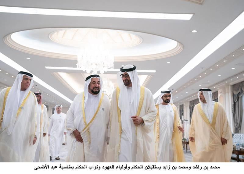 ABU DHABI, UNITED ARAB EMIRATES - August 21, 2018: HH Sheikh Saud bin Saqr Al Qasimi, UAE Supreme Council Member and Ruler of Ras Al Khaimah (L), HH Dr Sheikh Sultan bin Mohamed Al Qasimi, UAE Supreme Council Member and Ruler of Sharjah (2nd L), HH Sheikh Mohamed bin Zayed Al Nahyan, Crown Prince of Abu Dhabi and Deputy Supreme Commander of the UAE Armed Forces (3rd L), HH Sheikh Mohamed bin Rashid Al Maktoum, Vice-President, Prime Minister of the UAE, Ruler of Dubai and Minister of Defence (4th L) and HH Sheikh Mansour bin Zayed Al Nahyan, UAE Deputy Prime Minister and Minister of Presidential Affairs (R), attend an Eid Al Adha reception at Mushrif Palace. ( Hamad Al Kaabi / Crown Prince Court - Abu Dhabi )---