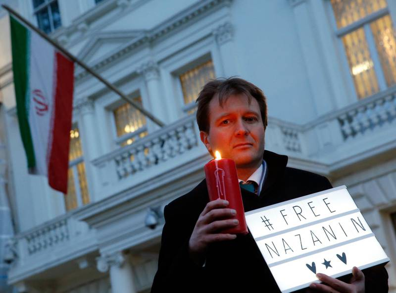 FILE - In this file photo dated Monday, Jan. 16, 2017, Richard Ratcliffe husband of imprisoned charity worker Nazanin Zaghari-Ratcliffe, poses for the media during an Amnesty International led vigil outside the Iranian Embassy in London.  Richard Ratcliffe said Tuesday May 15, 2018, that his wife may face new charges. (AP Photo/Alastair Grant, FILE)