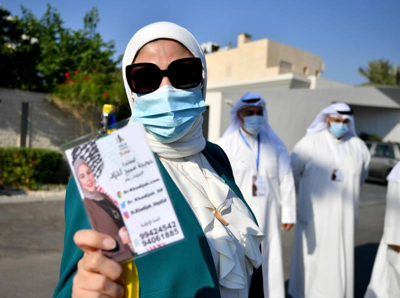 epa08774916 Khadija al-Qallaf, arrives to file candidacy papers for the upcoming parliamentary elections, at elections registration center in Kuwait City, Kuwait, 26 October 2020. Parliamentary elections in Kuwait are scheduled for 05 December.  EPA/NOUFAL IBRAHIM