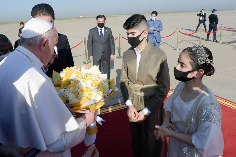 Pope Francis is welcomed at Erbil International Airport in Erbil, Iraq March 7, 2021. Vatican Media/Handout via REUTERS    ATTENTION EDITORS - THIS IMAGE WAS PROVIDED BY A THIRD PARTY.