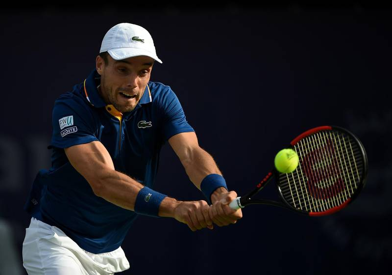 DUBAI, UNITED ARAB EMIRATES - FEBRUARY 28:  Roberto Bautista Agut of Spain plays a forehand during his match against Pierre-Hugues Herbert of France on day three of the ATP Dubai Duty Free Tennis Championships at the Dubai Duty Free Stadium on February 28, 2018 in Dubai, United Arab Emirates.  (Photo by Tom Dulat/Getty Images)