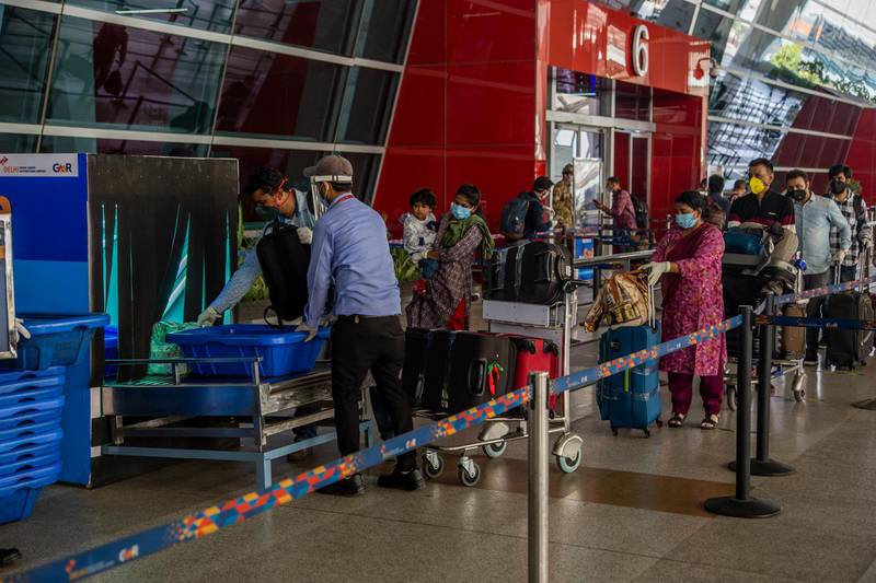 DELHI, INDIA - MAY 26: Travelers put their luggage in X-ray machine before at the drop-off point before entering Terminal 3 of the Indira Gandhi International Airport, as the country relaxed its lockdown restriction on May 26, 2020 in Delhi, India. With a slew of guidelines for passengers, India allowed commercial domestic flights to resume operations on May 25 for the first time since imposing a nationwide lockdown on March 25 to curb the spread of coronavirus, which has reportedly claimed around 4,000 lives in India so far.  (Photo by Yawar Nazir/Getty Images)