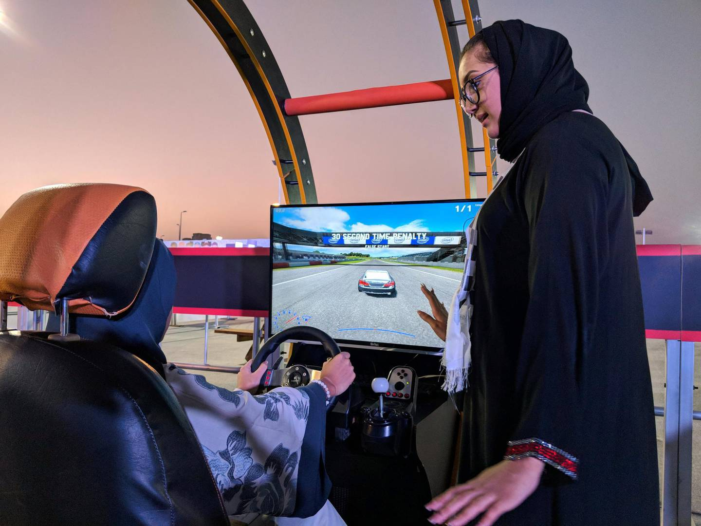 Rohood Bugis, as she takes to the wheel of the virtual training area in the CIc.  Amina Abu Al Ola is the trainer advising her