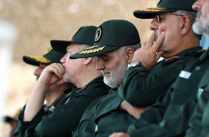 """In this June 30, 2018 photo, released by an official website of the office of the Iranian supreme leader, Gen. Qassem Soleimani, center, who heads the elite Quds Force of Iran's Revolutionary Guard attends a graduation ceremony of a group of the guard's officers in Tehran, Iran. Soleimani said Thursday his forces are ready if President Donald Trump follows through on his warning that Iran will """"suffer consequences"""" if Tehran threatens the United States. (Office of the Iranian Supreme Leader via AP)"""