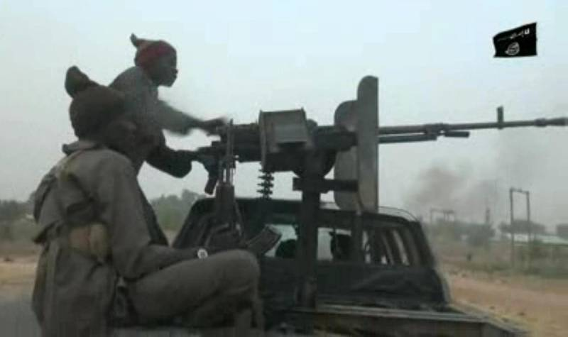 """This screen grab image taken on January 2, 2018 from a video released on January 2, 2018 by Islamist group Boko Haram shows Boko Haram fighters during a Christmas Day attack on a military checkpoint in Molai village on the outskirts of the northeast Nigerian city of Maiduguri, which the military said was thwarted by troops after one hour of battle. - Boko Haram leader Abubakar Shekau released his first video message in months amid a surge in violence casting doubt on the Nigerian government's claim that the jihadist group is defeated. (Photo by Handout / BOKO HARAM / AFP) / RESTRICTED TO EDITORIAL USE - MANDATORY CREDIT """"AFP PHOTO / BOKO HARAM"""" - NO MARKETING NO ADVERTISING CAMPAIGNS - DISTRIBUTED AS A SERVICE TO CLIENTS"""