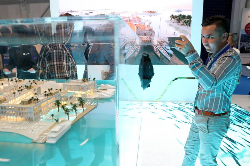 Dubai, United Arab Emirates - September 11th, 2017: Visitors at the Floating Venice project by Kleindienst at the 16th addition of Cityscape Global. Monday, September 11th, 2017 at World Trade centre, Dubai.