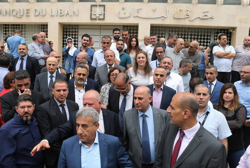 Employees of the Lebanese central bank gather during a strike over state budget proposals that would cut their benefits, in front of the central bank in Beirut, Lebanon May 6, 2019. REUTERS/Mohamed Azakir