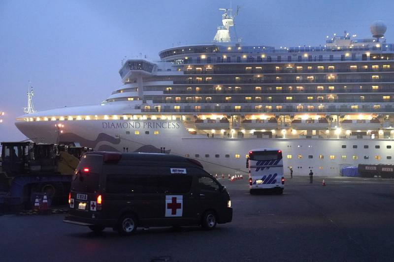 A coach and an ambulance travel towards the Diamond Princess cruise ship, operated by Carnival Corp., docked at dusk in Yokohama, Japan, on Sunday, Feb. 16, 2020. Aircraft chartered by the U.S. State Department are to arrive Sunday in Japan to evacuate about 400 citizens from the Diamond Princess. Photographer: Toru Hanai/Bloomberg