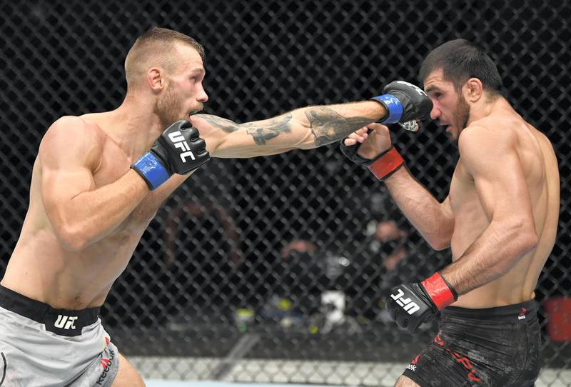 ABU DHABI, UNITED ARAB EMIRATES - JULY 26: (L-R) Niklas Stolze of Germany punches Ramazan Emeev of Russia in their welterweight fight during the UFC Fight Night event inside Flash Forum on UFC Fight Island on July 26, 2020 in Yas Island, Abu Dhabi, United Arab Emirates. (Photo by Jeff Bottari/Zuffa LLC via Getty Images) *** Local Caption *** ABU DHABI, UNITED ARAB EMIRATES - JULY 26: (L-R) Niklas Stolze of Germany punches Ramazan Emeev of Russia in their welterweight fight during the UFC Fight Night event inside Flash Forum on UFC Fight Island on July 26, 2020 in Yas Island, Abu Dhabi, United Arab Emirates. (Photo by Jeff Bottari/Zuffa LLC via Getty Images)