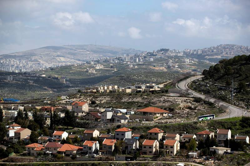 Houses in the Israeli settlement of settlement of Kedumim are seen in the foreground as part of the Palestinian city of Nablus is seen in the background (far left) in the Israeli-occupied West Bank February 20, 2020. Picture taken February 20, 2020. REUTERS/Ronen Zvulun