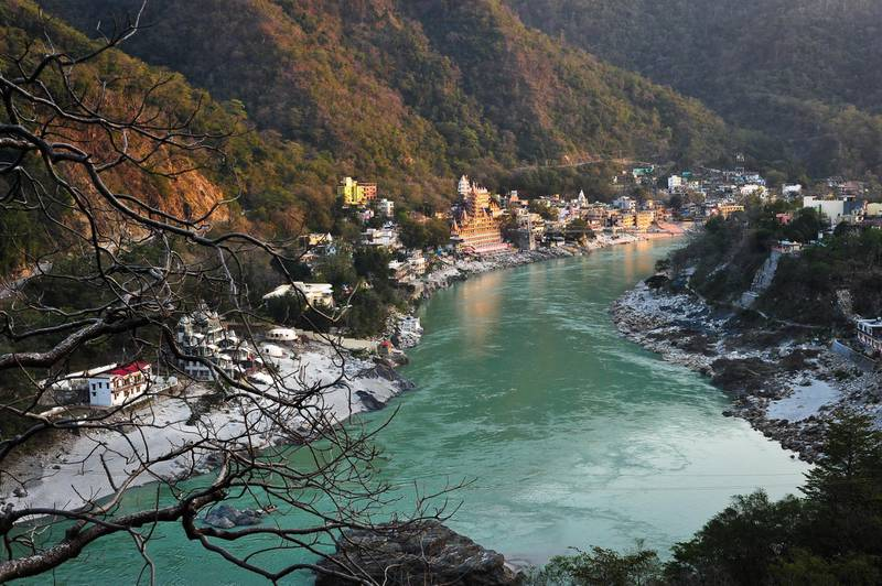 A view of the Ashrams next to the Ganges River at sunset in Rishikesh, Uttarakhand, India. Getty Images