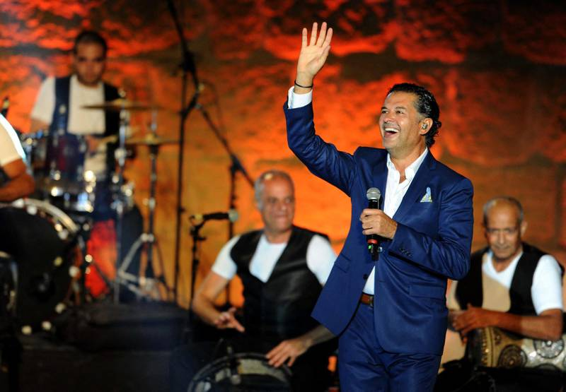 Lebanese singer Ragheb Alama performs during the 53rd session of the International Festival of Carthage at the Roman Theatre of Carthage on July 19, 2017 in Tunis. (Photo by SALAH HABIBI / AFP)