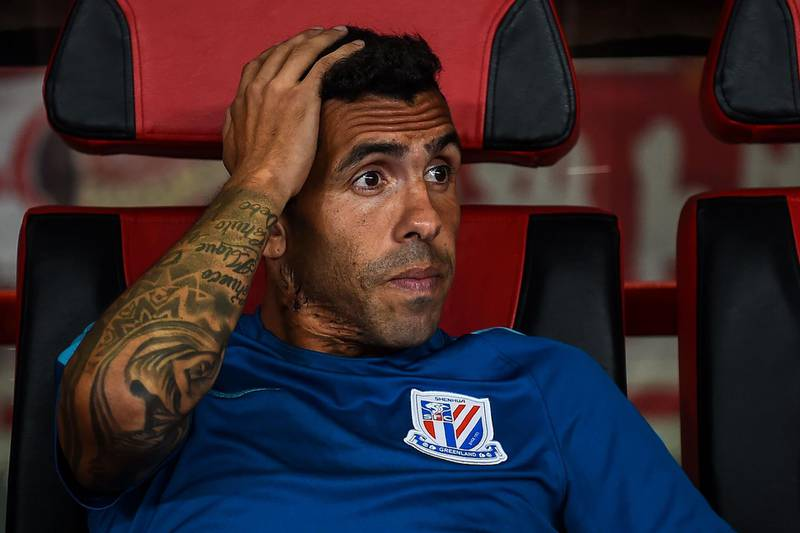 (FILES) This file picture taken on September 16, 2017 shows Shanghai Shenhua's Carlos Tevez looking on during the 2017 Chinese Super League football match between Shanghai East Asia (SIPG) FC and Shanghai Shenhua in Shanghai. Carlos Tevez looks poised to end his miserable 12-month spell in China with the Argentine former international in talks with his club Shanghai Shenhua to terminate his mammoth contract. A Shenhua spokesman told AFP on January 5, 2018 that the club was in discussions with the former Manchester United, Manchester City and Juventus striker to end his contract. / AFP PHOTO / Chandan KHANNA /  - China OUT
