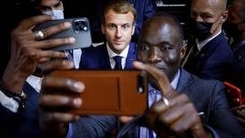 Today's best photos: from selfies with Macron to astronauts at a volcano