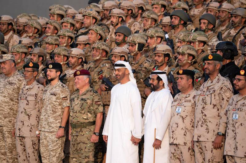 AL DHAFRA REGION, ABU DHABI, UNITED ARAB EMIRATES - June 26, 2019: HE Lt General Hamad Thani Al Romaithi, Chief of Staff UAE Armed Forces (front row 2nd L), HRH Hussein bin Abdullah, Crown Prince of Jordan (front row 3rd L), HM King Abdullah II, King of Jordan (front row 4th L), HH Sheikh Mohamed bin Zayed Al Nahyan, Crown Prince of Abu Dhabi and Deputy Supreme Commander of the UAE Armed Forces (front row 5th L), HH Sheikh Tahnoon bin Mohamed Al Nahyan, Ruler's Representative in Al Ain Region (front row 6th L) and HE Brigadier General Saleh Mohamed Saleh Al Ameri, Commander of the UAE Ground Forces (front row 8th L), stand for a photograph with members of the UAE Armed Forces and the Jordanian Armed Forces, after a joint military drill, Titled 'Bonds of Strength', at Al Hamra Camp.  ( Mohamed Al Hammadi / Ministry of Presidential Affairs ) ---