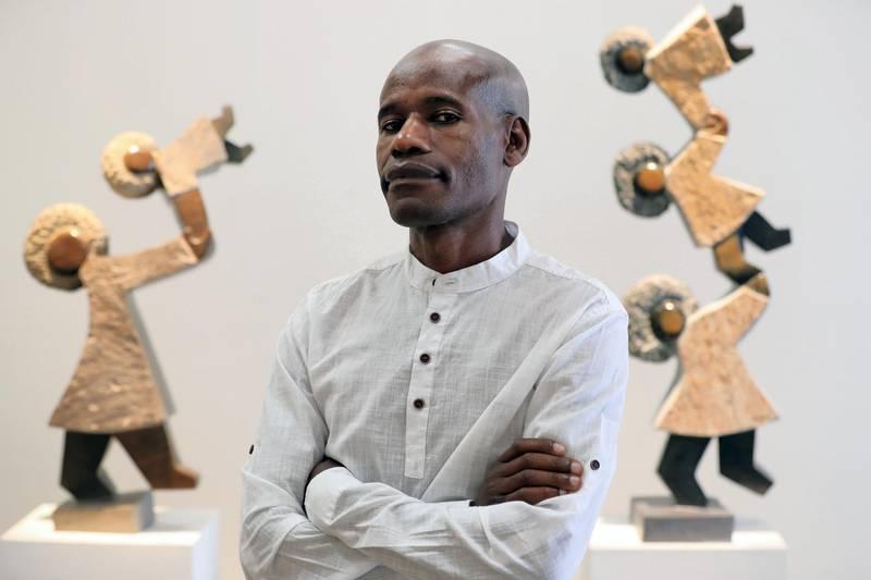 Dubai, United Arab Emirates - November 19, 2019: Sculptor Dominic Benhura who has show at Showcase Gallery called 'Between Me and The Stone'. Tuesday, November 19th, 2017 at Alserkal Avenue, Dubai. Chris Whiteoak / The National