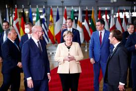 EU leaders in standing ovation for Angela Merkel as they seek migration plan