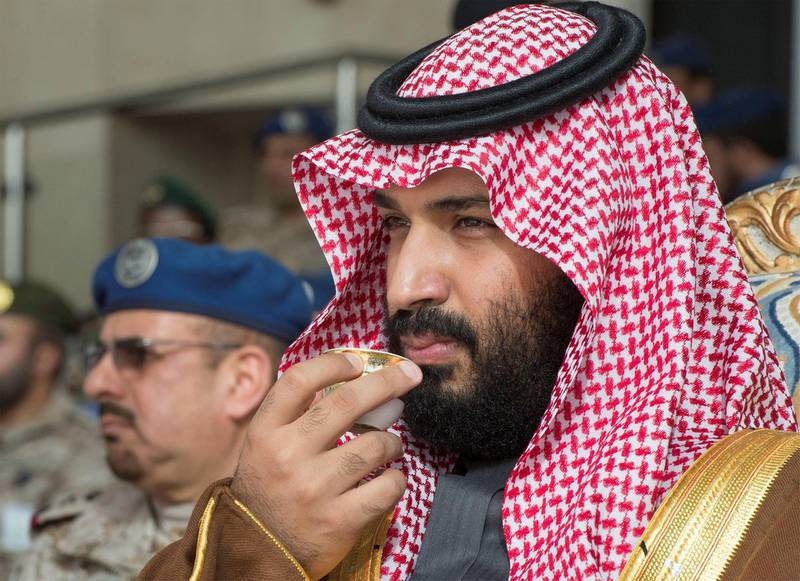 Saudi Arabia's Crown Prince Mohammed bin Salman drinks coffee during the graduation ceremony of the 93rd batch of the cadets of King Faisal Air Academy, in Riyadh, Saudi Arabia, February 21, 2018. Bandar Algaloud/Courtesy of Saudi Royal Court/Handout via REUTERS ATTENTION EDITORS - THIS PICTURE WAS PROVIDED BY A THIRD PARTY.