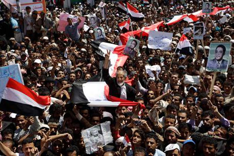 """Anti-government protesters shout slogans during a protest demanding the ouster of Yemen's President Ali Abdullah Saleh outside Sanaa University March 1, 2011. Tens of thousands of protesters flooded Yemen's streets on Tuesday, dedicating a fresh """"Day of Rage"""" to the 24 people killed in demonstrations demanding an end to the Saleh's three-decade rule.  REUTERS/Ammar Awad (YEMEN - Tags: POLITICS CIVIL UNREST)"""