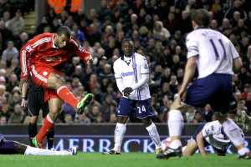 LIVERPOOL, ENGLAND - MARCH 15:  Ryan Babel of Liverpool scores his team's second goal during the Barclays Premier League match between Liverpool and Portsmouth at Anfield on March 15, 2010 in Liverpool, England. (Photo by Alex Livesey/Getty Images) *** Local Caption ***  GYI0059914881.jpg *** Local Caption ***  GYI0059914881.jpg