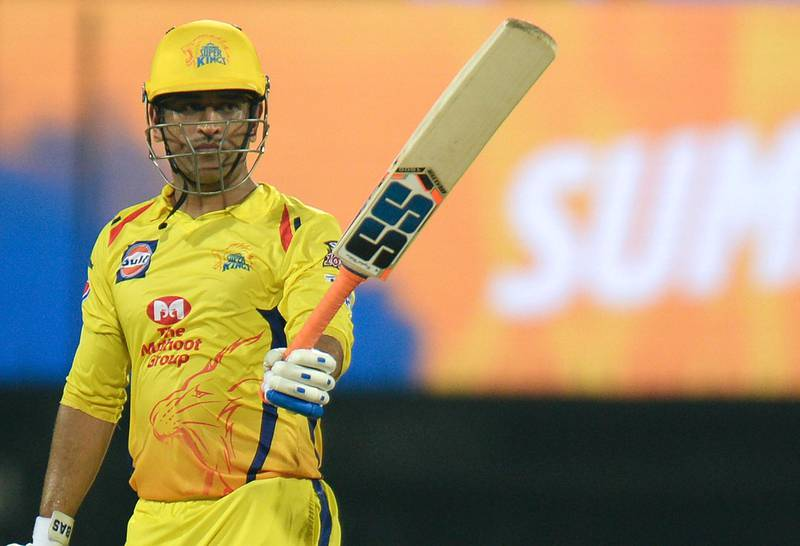 Chennai Super Kings cricket captain Mahendra Singh Dhoni raises his bat as he celebrates after scoring a fifty (50) runs during the 2019 Indian Premier League (IPL) Twenty20 cricket match between Chennai Super Kings and Rajasthan Royals at the M.A. Chidambaram Stadium in Chennai on March 31, 2019. (Photo by ARUN SANKAR / AFP) / ----IMAGE RESTRICTED TO EDITORIAL USE - STRICTLY NO COMMERCIAL USE-----