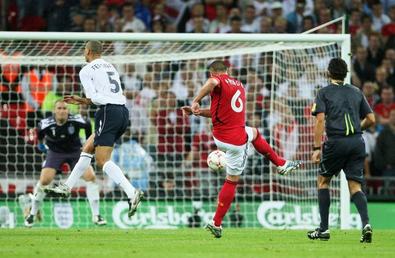 LONDON - AUGUST 22: Christian Pander of Germany scores a goal during the international friendly match between England and Germany at Wembley stadium on August 22, 2007 in London, England.  (Photo by Phil Cole/Getty Images)