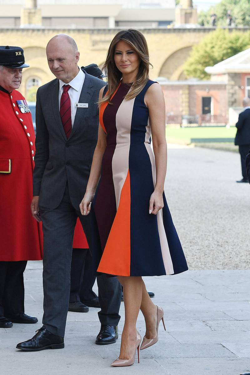 LONDON, ENGLAND - JULY 13:  First Lady, Melania Trump is greeted by Royal Hospital CEO Gary Lashko, as she arrives to meet British Army veterans, known as Chelsea Pensioners, at Royal Hospital Chelsea on July 13, 2018 in London, England. First Lady, Melania Trump, visited the Chelsea Pensioners while her husband, President Donald Trump, held bi-lateral talks with Theresa May at the Prime Minister's Country Residence. The Chelsea Pensioners are British Army personnel who are cared for at the Services retirement home at The Royal Hospital in London.  (Photo by Leon Neal/Getty Images)