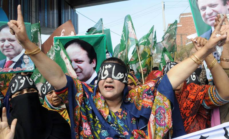 epaselect epa06560605 Supporters of former Prime Minister Nawaz Sharif wear headbands reading in Urdu 'Blind Justice' during a protest after the Supreme Court barred him from leading the ruling Pakistan Muslim League Nawaz, in Multan, Pakistan, 24 February 2018. The Supreme Court of Pakistan announced on 21 February the verdict it reserved on Election Act 2017, declaring former prime minister Nawaz Sharif ineligible to head his own party, Pakistan Muslim League-Nawaz (PML-N). Nawaz Sharif and his sons are inducted in corruption references, after the National Accountability Bureau, an anti-corruption body, opened three cases, related to ownership of property at an exclusive zone in London; the creation of the firms Azizia Steel and Hill Metal; and the Flagship investment firm, as well as another 15 companies, on the orders of the Supreme Court.  EPA/FAISAL KAREEM
