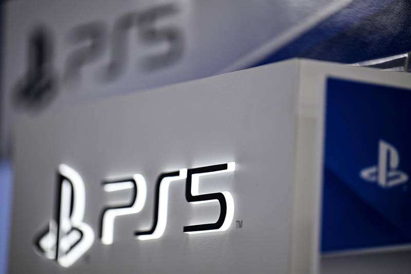 Sony's Playstation 5 logo is seen at an electronics store in Tokyo on November 10, 2020, ahead of the gaming console's release scheduled for November 12.  / AFP / CHARLY TRIBALLEAU