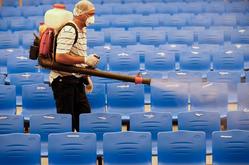 epa08280109 A city worker disinfects auditorium after classes were suspended for sanitation operations in an elementary school in Cainta town of Rizal province, east of Manila, Philippines 09 March 2020. Philippine President Rodrigo Duterte placed the country under a state of public health emergency amidst the Covid-19 coronavirus situation. Philippine health officials have confirmed 10 cases of the Covid-19 coronavirus, including two from Cainta town.  EPA/ROLEX DELA PENA