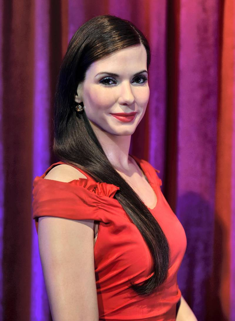 The wax figure of US actress Sandra Bullock during an its unveiling at Madame Tussauds in New York's Times Square July 23, 2014. AFP PHOTO/Stan HONDA (Photo by STAN HONDA / AFP)