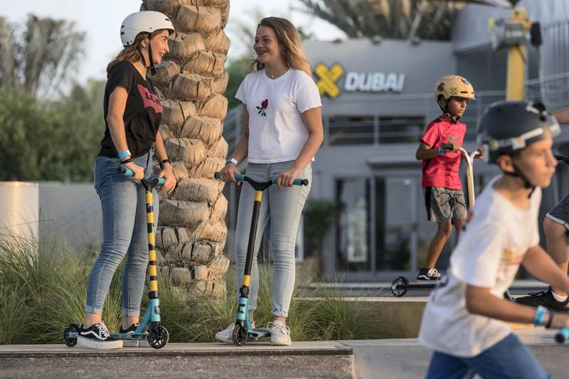 DUBAI, UNITED ARAB EMIRATES. 12 October 2017.  Skater girl article. A groth in girls taking up wheeled extreme sports has been noticed at the X Dubai Skate Park next to Kite Beach. Lea Salem (Canada 13) chats to her friend Blanche Battistella (Canada 13) while on their push scooters. (Photo: Antonie Robertson/The National) Journalist: Nick Webster. Section: National.