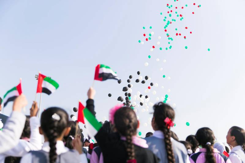 FUJAIRAH, UNITED ARAB EMIRATES - NOV 28:  Balloons with the colors of the UAE flag fly up Fujairah skies.  Al Fujairah began it's UAE National Day celebrations with a national parade.  (Photo by Reem Mohammed/The National)  Reporter:  Ruba Haza Section: NA
