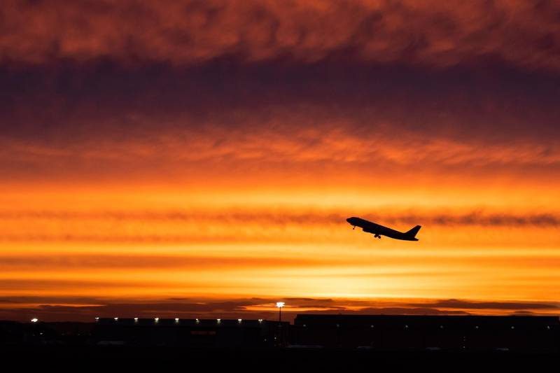 An aircraft takes off at sunrise at Duesselorf airport on January 10, 2019. Almost 640 flights were cancelled in Germany January 10, 2019 as security staff went on strike at three airports, Duesseldorf, Cologne-Bonn and Stuttgart, meaning disruption for around 100,000 passengers.   - Germany OUT  / AFP / dpa / Marcel Kusch