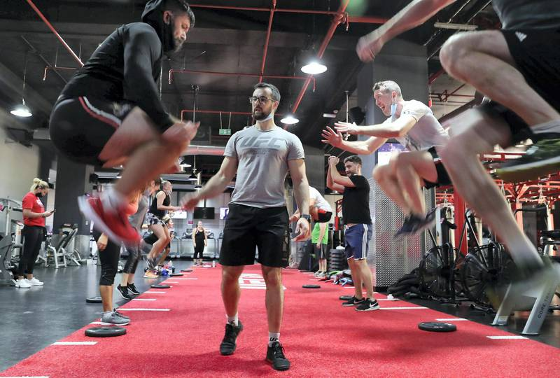 DUBAI, UNITED ARAB EMIRATES , August 10 – 2020 :- Participants during the daily ultimate training session at the UFC Gym in Murjan 6 in Jumeirah Beach Residence in Dubai. They are taking part in the 90 minutes MMA Mash up. (Pawan Singh / The National) For News/Online/Instagram. Story by Nick Webster