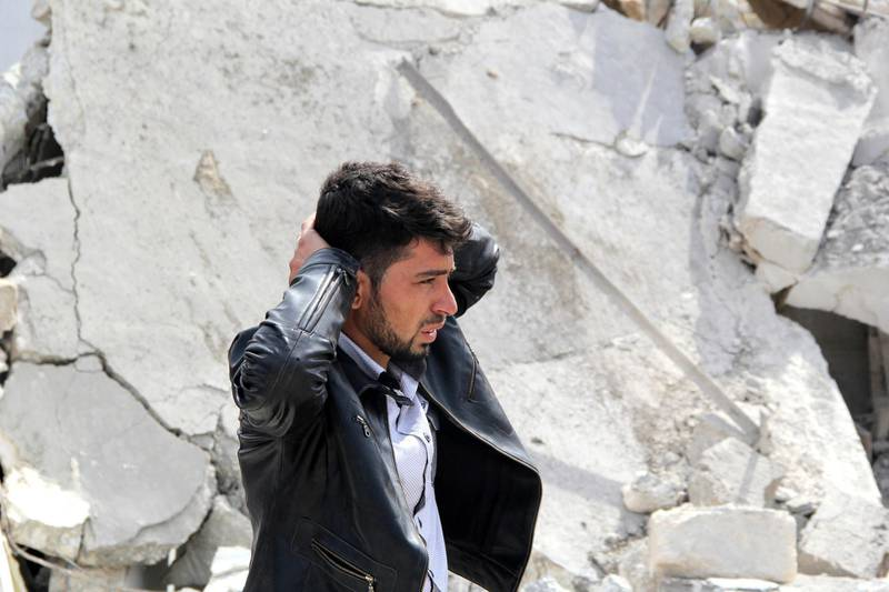 A man reacts to the destruction of his home following a reported air strike by government forces on the northern Syrian city of Aleppo on February 22, 2014. More than 140,000 people have been killed in Syria's conflict since March 2011, and millions more have fled their homes. AFP PHOTO/MOHAMMED AL-KHATIEB (Photo by MOHAMMED AL-KHATIEB / MOHAMMED AL-KHATIEB / AFP)