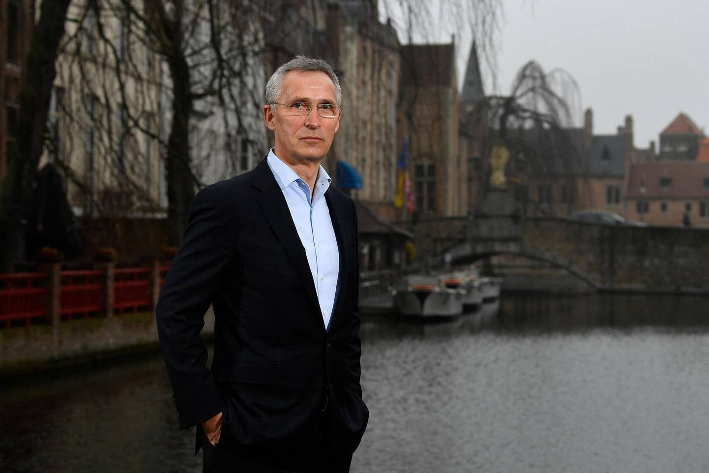 """NATO Secretary General Jens Stoltenberg poses after an interview with AFP at the College of Europe in Bruges, on March 4, 2021. NATO Secretary General Jens Stoltenberg warned on March 4, that the European Union cannot defend its citizens alone without the help of the trans-Atlantic alliance. Some EU leaders have been pushing for their union to develop more """"strategic autonomy"""", a move which some see as setting up a rivalry between Brussels and Washington. But Stoltenberg, a guest at the College of Europe, said that EU member states that were members of NATO made up only a fifth of the total alliance defence spending that protects European shores.  / AFP / JOHN THYS"""