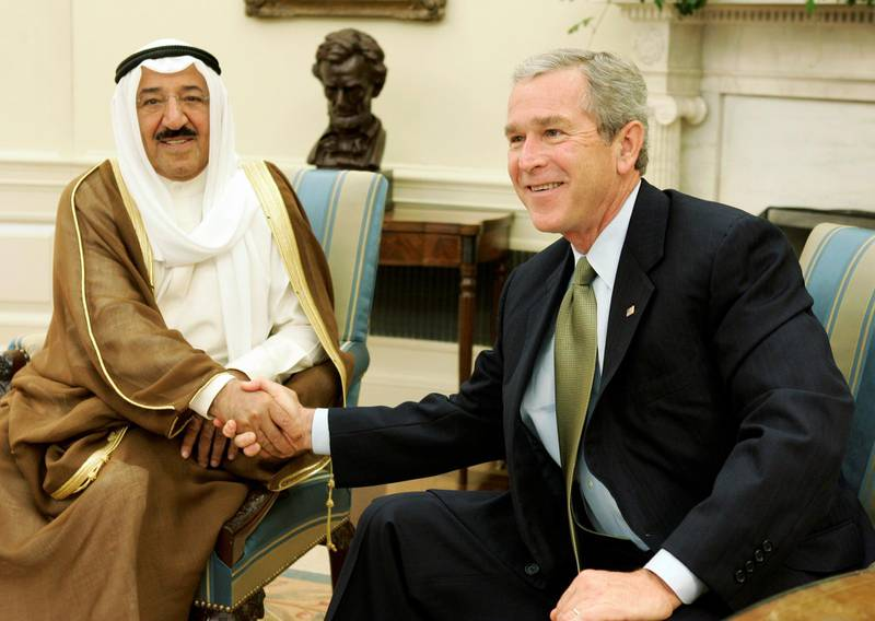 U.S. President George W. Bush (R) shakes hands with Kuwait's Prime Minister Sabah al-Ahmad al-Jaber al-Sabah in the Oval Office of the White House in Washington, DC July 1, 2005. Sabah al-Ahmad al-Jaber al-Sabah is in Washington on an official visit. REUTERS/Jason Reed  JIR/CN