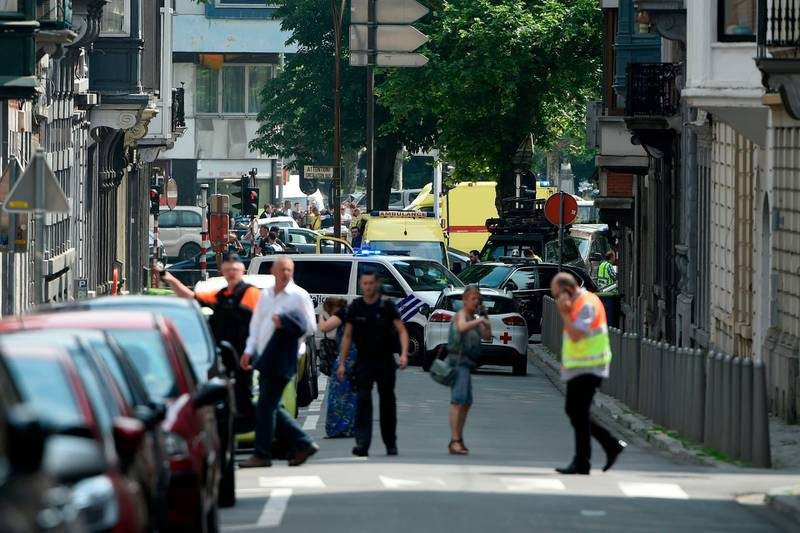 Police and ambulance are seen at the site where an armed man shot and killed police officers before being subdued by police in the eastern Belgian city of Liege on May 29, 2018.   / AFP / JOHN THYS