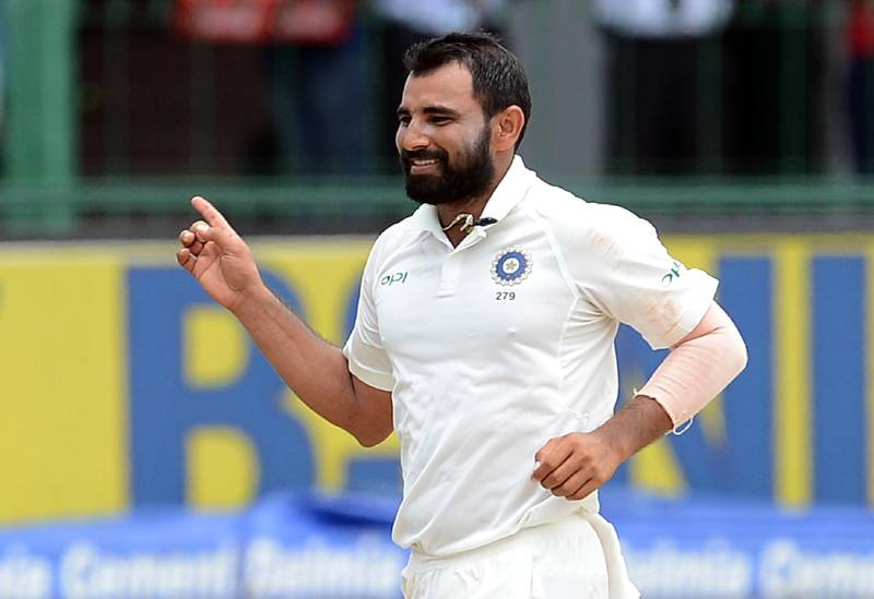 India's Mohammed Shami celebrates after he dismissed Sri Lanka's Niroshan Dickwella during the third day of the second Test cricket match between Sri Lanka and India at the Sinhalese Sports Club (SSC) Ground in Colombo on August 5, 2017. / AFP PHOTO / LAKRUWAN WANNIARACHCHI